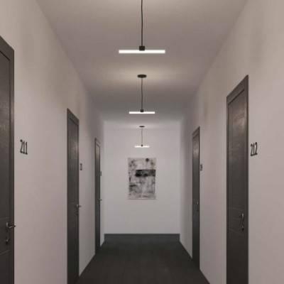 Lámpara colgante hecha en Italia con cable textil, portalámparas S14d Syntax® y detalles de metal